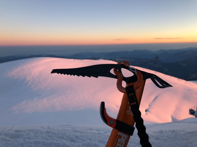 Orange Saw in snowy Haute Savoie mountain at sunset